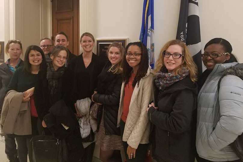 Members of HECSE standing in front of a legislators office in Washington DC.